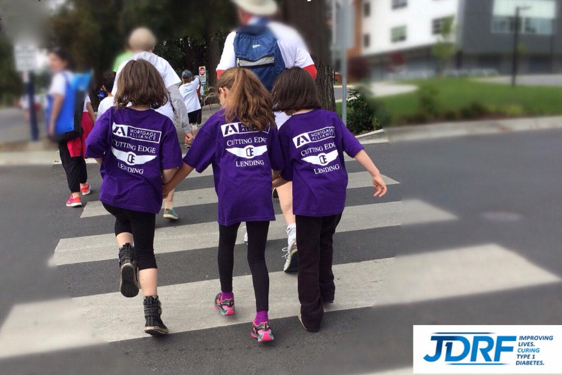 image of three girls crossing the street